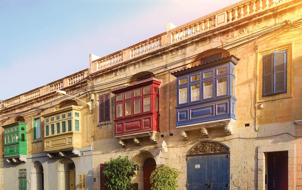 Street with traditional colorful balconies in Malta