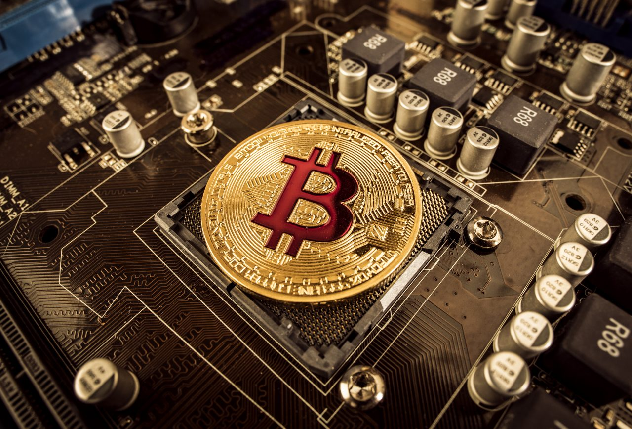 gold-bit-coin-btc-coins-on-the-motherboard-bitcoin-PHZGYQU-1280x868.jpg