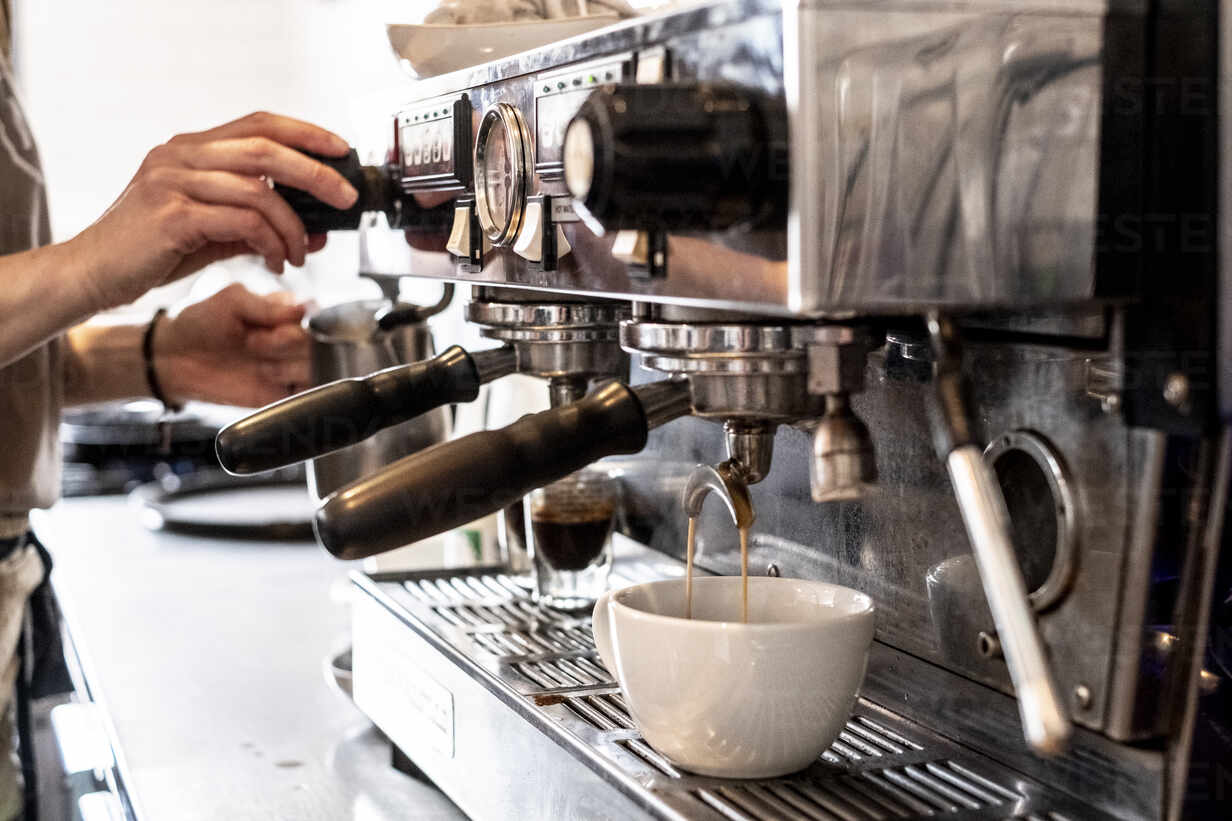 close-up-of-person-making-a-cappuccino-using-commercial-espresso-machine-MINF13163.jpg